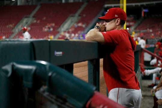 Cincinnati Reds manager David Bell (25) watches from the dugout in the eighth inning of the MLB National League game between the Cincinnati Reds and the Philadelphia Phillies at Great American Ball Park in downtown Cincinnati on Tuesday, Sept. 3, 2019. The game was tied 1-1 after three innings.