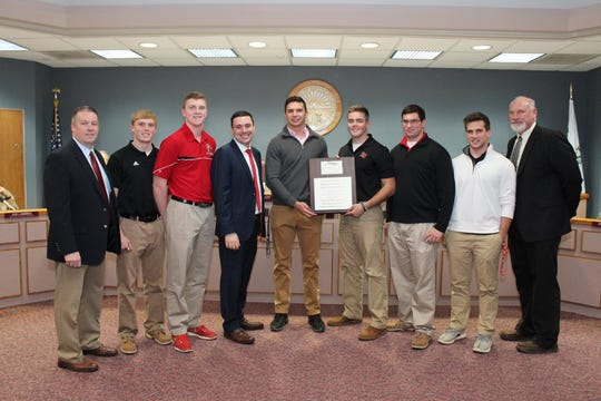 Tom Doerger has been a part of La Salle's three state title teams as offensive line coach. Representatives from the La Salle High School football team receive a plaque from the Green Township Board of Trustees commemorating the 2016 Division II State Football Championship. From left Greg Tankersley, executive director, LaSalle; Brady Reynolds; Bobby Froehlich; Triffon Callos, Green Township Trustee; Ethan Campbell; Nate Boeckermann; Nick Rielag; Shane Dashley and Tom Doerger La Salle coach and guidance counselor.