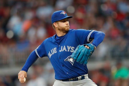 Toronto Blue Jays pitcher T.J. Zeuch works against the Atlanta Braves during the second inning of a baseball game Tuesday, Sept. 3, 2019, in Atlanta.
