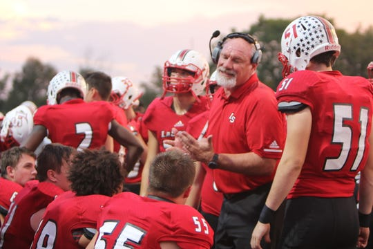 "La Salle offensive line coach  Tom Doerger instructs his ""grunts"". Doerger is recovering from a liver transplant and hopes to return to the Lancers by playoff time."
