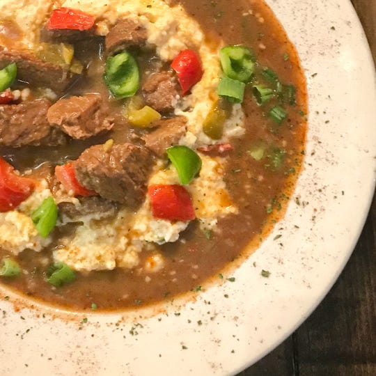 Grillades and Grits, offered at Roux in Clarksville for Sunday brunch.
