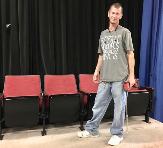 N&J Flooring's Jeremy Tipton discovered the playbill and tickets when a row of old Trahern Theatre seats toppled on top of him.