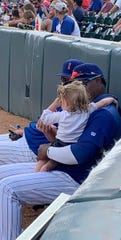Iowa Cubs pitcher Randy Rosario hangs out with Harper Haynes in the bullpen