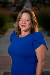 Iowa State Director for John Delany, Monica Biddix, poses for a portrait on Tuesday, Sept. 3, 2019 in Des Moines.