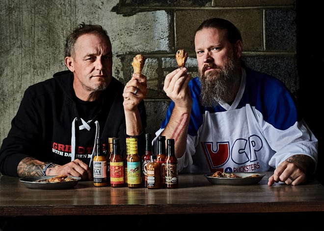 Darren McCarty and Jay Adams take on chicken wings and hot sauce at Frame.