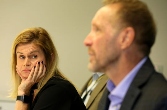 Hilarie Chambers the deputy county executive of Oakland County listens to David Coulter, the county executive of Oakland County talk with the Detroit Free Press editorial board at the newspaper's offices on Wednesday, September 4, 2019.