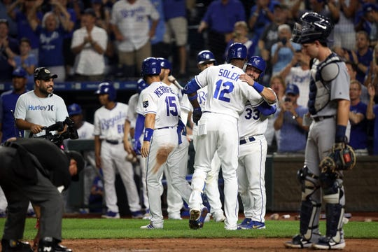 Jorge Soler #12 of the Kansas City Royals is congratulated by teammates after hitting his 39th home run of the year, a single-season club record, during the 3rd inning of the game against the Detroit Tigers at Kauffman Stadium on September 03, 2019 in Kansas City, Missouri.