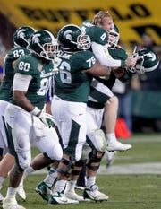 Dec. 29, 2012: Michigan State 17, TCU 16, Sun Devil Stadium: Dan Conroy hit a 47-yard field goal with 1:01 remaining as MSU won the Buffalo Wild Wings Bowl, salvaging a lost season by forcing two turnovers and leaning on Le'Veon Bell, who ran for 145 yards and a score.