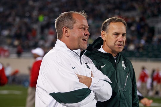 Mark Hollis and Mark Dantonio, Oct. 22, 2011 before Michigan State played Wisconsin at Spartan Stadium.