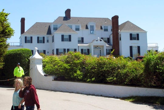 In this May 27, 2013 photo, people walk past a house owned by Taylor Swift in the village of Watch Hill in Westerly, R.I. Richard Joseph McEwan, of Milford, N.J., was arrested on Friday, Aug. 30, 2019, and charged with breaking into Swift's Westerly, R.I., oceanfront house.