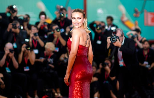 Scarlett Johansson poses for photographers upon arrival at the premiere of the film 'Marriage Story' at the 76th edition of the Venice Film Festival, Venice, Italy, Thursday, Aug. 29, 2019.