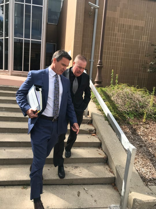 Former United Auto Workers official Mike Grimes, right, appeared in federal court in Ann Arbor for a plea hearing in September with his lawyer, Michael Manley.