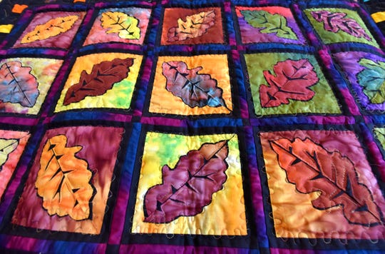 This multi-colored quilt, handmade by president Wanda Nash, is called Autumn Leaves.