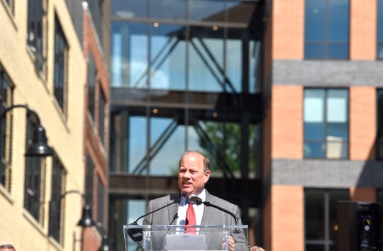 Mayor Mike Duggan addresses the group at the Elton Park opening in Corktown on Wednesday.