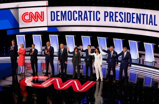 Sen. Michael Bennet, D-Colo., Sen. Kirsten Gillibrand, D-N.Y., former Housing and Urban Development Secretary Julian Castro, Sen. Cory Booker, D-N.J., former Vice President Joe Biden, Sen. Kamala Harris, D-Calif., Andrew Yang, Rep. Tulsi Gabbard, D-Hawaii, Washington Gov. Jay Inslee and New York City Mayor Bill de Blasio are introduced before the second of two Democratic presidential primary debates hosted by CNN in the Fox Theatre in Detroit.