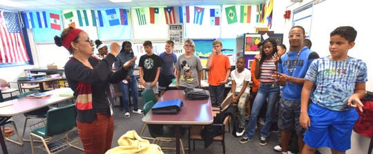 Seventh-grade AVID teacher Elaine Zold, left, splits her students into two teams as they play the team-building game, Rock, Paper, Scissors at Ferndale Middle School.