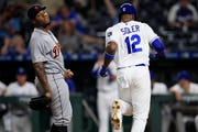 Kansas City Royals' Jorge Soler (12) scores after a wild pitch by Detroit Tigers relief pitcher Gregory Soto, left, during the eighth inning Tuesday. The Royals won 6-5.