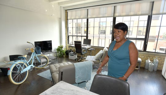Felicia Sears, a Checker Cab Building resident, shows off her living room.