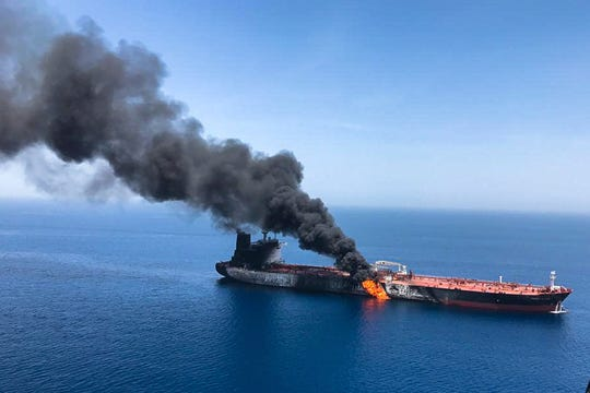 FILE - In this June 13, 2019 file photo, an oil tanker is on fire in the Gulf of Oman. The U.S. Navy is trying to put together a new coalition of nations to counter what it sees as a renewed maritime threat from Iran. Meanwhile, Iran finds itself backed into a corner and ready for a possible conflict. It stands poised on Friday, Sept. 6, 2019, to further break the terms of its 2015 nuclear deal with world powers.