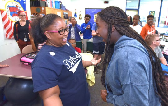 Ferndale Middle School student Janay Cunningham, left, of Warren, beats classmate Jada Pearson at rock-paper-scissors during an AVID elective class, which is designed to narrow achievement gaps.