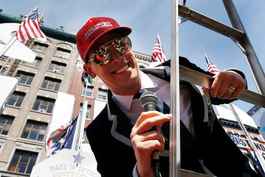 """Milo Yiannopoulos address the crowd during the Straight Pride Parade in Boston, Saturday, Aug. 31, 2019. Several dozen marchers and about as many counter-demonstrators have gathered in Boston for a """"straight pride"""" parade. The organizers say they believe straight people are an oppressed majority."""