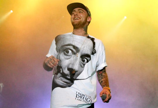 In this July 13, 2013, file photo, rapper Mac Miller performs on his Space Migration Tour in Philadelphia. A man has been charged with selling counterfeit opioid pills to Mac Miller two days before the rapper died of an overdose.  An autopsy found that the 26-year-old Miller died in his Los Angeles home on Sept. 7 from a combination of fentanyl, cocaine and alcohol.