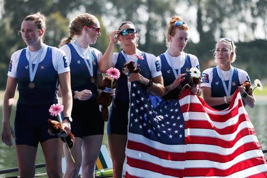 Watkins Glen's Olivia Coffey, left, with teammates after the United States won the bronze medal in the women's eight final at the 2019 World Rowing Championships on September 1, 2019 in Linz-Ottensheim, Austria.
