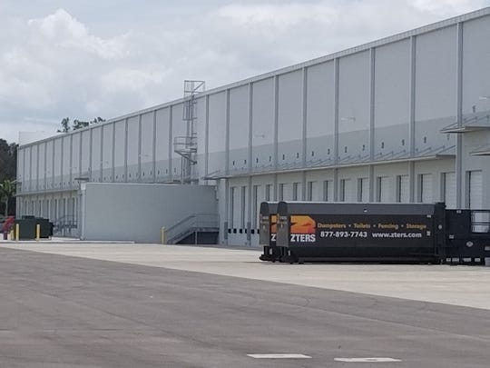 A warehouse and distribution terminal on Ben Hill Griffin Parkway near Alico Road carries design factors some county officials want continued inthe newly approved Florida Coast Technology center, combining an attractive front, but with an industrial purpose when viewed from behind the gate.
