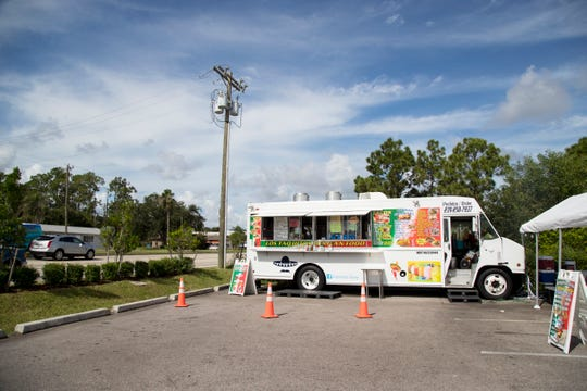 Los Taquitos Mexican Food truck is set up for lunch on Lee Boulevard in the parking lot of DebÕs Seafood in Lehigh Acres.