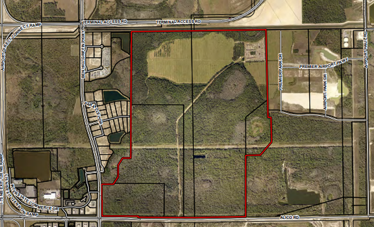A huge, one-square-mile commercial and industrial center has been approved for Lee County after the builder promised to make it look good from the street