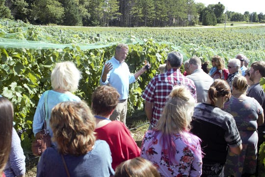 Parallel 44 Vineyard & Winery co-owner and winemaker Steve Johnson leads a tour at last year's Harvest Fest. This year's annual fall wine festival at Parallel 44 takes place Sept. 7.