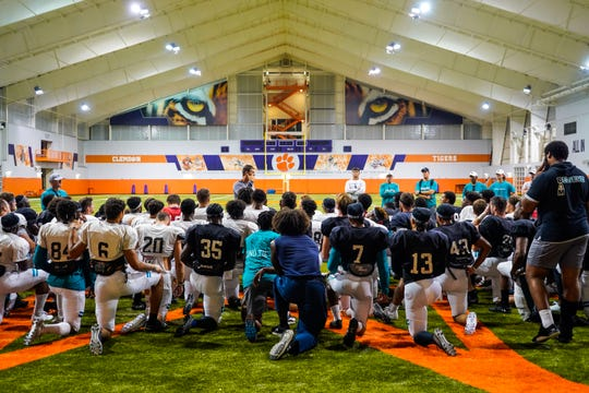 Coastal Carolina coach Jamey Chadwell addresses his team during Tuesday practice at Clemson's Poe Indoor Practice Facility.