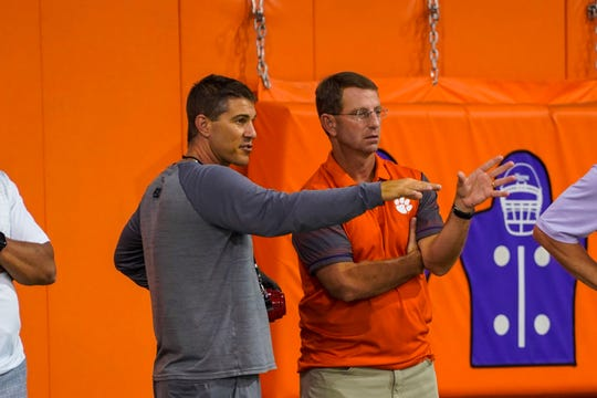Coastal Carolina football coach Jamey Chadwell, left, chats with Clemson coach Dabo Swinney during a practice session at Clemson on Tuesday.