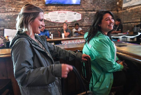 "Kate Ball, left, joins her friend Derrian Coupe, both of Georgetown, sit at Buzz's Roost, a restaurant and bar on Winyah Bay in Georgetown, South Carolina Wednesday, Septemeber 4, 2019. Locals come to the bar open through hurricane weather. Last year customers waded through water to get to the open restaurant with a bar. ""I can't sit at home and do nothing,"" Coupe said."