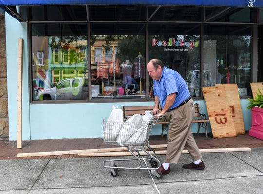 Tom Foose of Georgetown brings sandbags in a small cart to the front of Tomlinson's department store on Front Street in downtown Georgetown, South Carolina Wednesday, Septemeber 4, 2019. Built in 1904, the store is in the historic district and across the street from a the Fogel building where President George Washington stayed a night. Foose said he uses the same sandbags each year during Hurricane season. Foose, the manager of the store, said he uses the same sandbags each year during hurricane season.