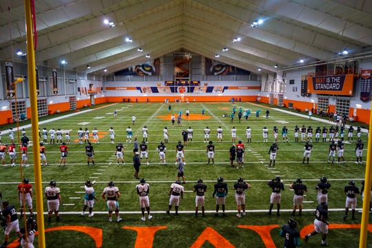Coastal Carolina's football team works out at Clemson's indoor practice facility on Tuesday after being displaced by Hurricane Dorian.