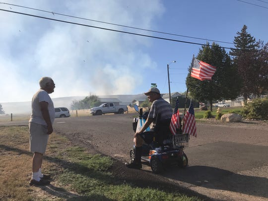 A fire came close to homes on Hill 57 late Wednesday evening.