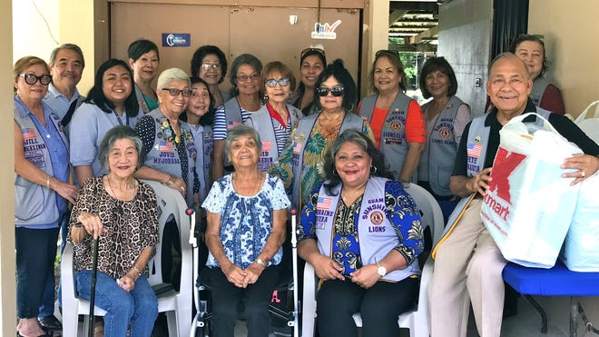 "In the spirit of fulfilling its project of ""caring for the sick and the elderly,"" the Guam Sunshine Lions Club visited Guadalupe C. Cordero, 79, on Aug. 17  at her residence in Agat. The members brought supplies and entertained the elderly resident with traditional CHamoru songs. Seated from left: Dolores Villasoto, family member; Cordero;  Lorraine Rivera, president; and Lion Pete Babauta. Standing from left: Lions Jill Pangelinan, John Villagomez, Nina Baluran, Marietta Camacho, Jovie Mejorada, Linda Villagomez, Sera Taitano, Dot Leon Guerrero, Sid Weedin, Tish Tano, Connie Rivera, Julie Cruz, Mary Taitano and Doris Cruz"