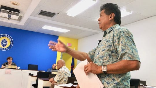 Yigo Mayor Rudy Matanane gestures as he talks about some solutions to control Guam's large stray dog population during a meeting with other mayors, the Guam Animals in Need and other agencies, on Sept. 4, 2019.