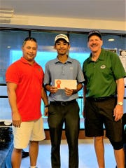 Regg Camacho, center, took the men's and overall title of the 2019 Nissan Guam Amateur Golf Championship with a two-day total of 147.  He is pictured with GNGF President Richard Sablan, left and Nissan Guam's President Van Shelly.