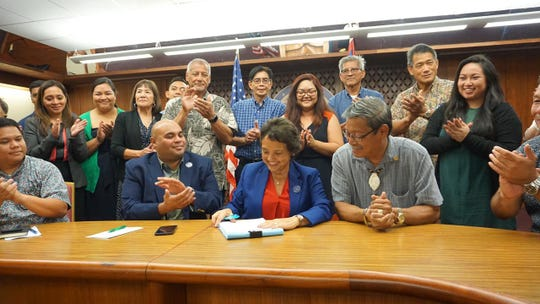 Gov. Lou Leon Guerrero signs into law the fiscal 2020 budget bill on Sept. 4.