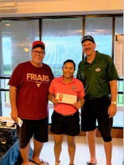 Kristin Oberiano won the women's division of the Nissan Guam Amateur Golf Championship. She is shown with tournament director Mike Bordallo, left and Nissan Guam president Van Shelly.