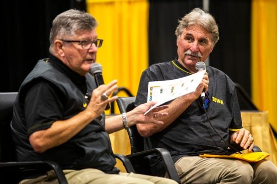 Ed Podolak, right, is thrilled to be back for another season with broadcasting partner Gary Dolphin (left, shown at last week's FryFest in Coralville). It's been 50 years since Podolak graduated from Iowa and was a rookie for the Super Bowl champion Kansas City Chiefs.