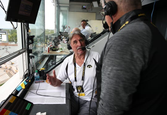 Iowa football color commentator Ed Podolak, left, has been working games with Gary Dolphin since 1996. Here, the two talk during the pregame show of the 2019 season opener vs. Miami (Ohio).