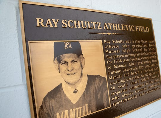 A plaque dedicated to Ray Schultz Athletic Field hangs on the side of a newly renovated concession stand.