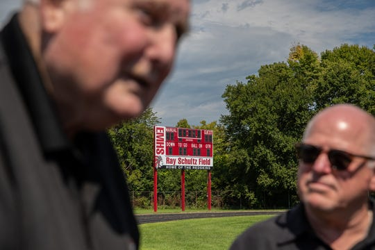 Ray Schultz, (left) whose name is on Manual's football field, and Mark Bowell, a 1981 Manual graduate, pose for a photograph near the school's new scoreboard on Sept. 3, 2019. Bowell helped lead a small group of donors to raise $12,000 for football field upgrades.