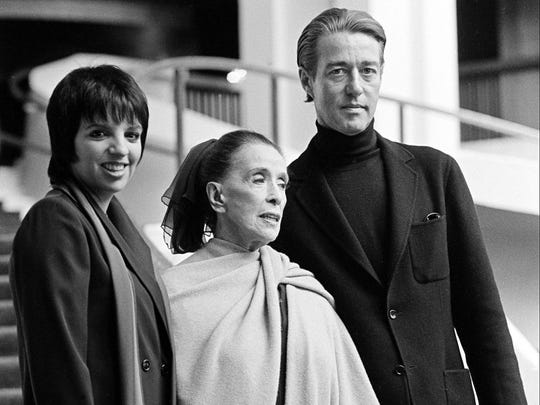 Fashion designer Halston, right, is pictured with Liza Minnelli, left, and choreographer Martha Graham, center, in 1980. Halston graduated from Evansville Bosse High School in 1950.