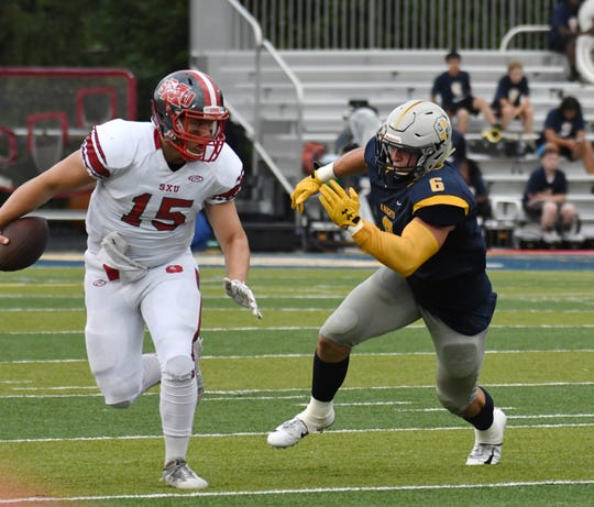 Marian defensive lineman Mac Dutra needs five sacks to break the school's all-time sack record.