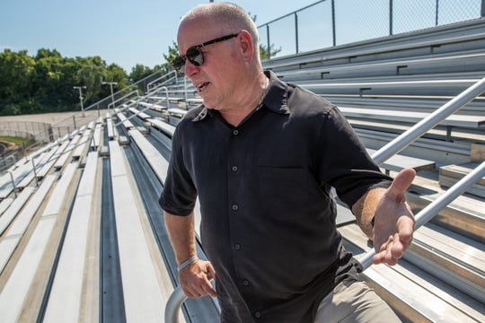 """There's that element of pride of being part of being a Redskin,"" said Mark Bowell, a 1981 Manual graduate, about wanting to help raise money for football field renovations. ""And for me, part of it too is, I don't want to see this place close."""