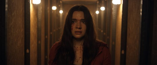 Katie Stevens as Harper in the horror / thriller HAUNT, a Momentum Pictures release.